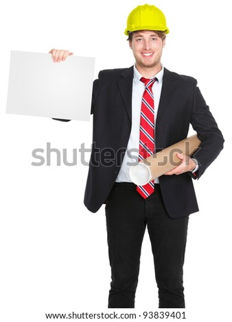 Engineer / architect man showing blank sign holding plans and wearing yellow construction work protective helmet. Young happy smiling caucasian male professional isolated on white background. - stock photo