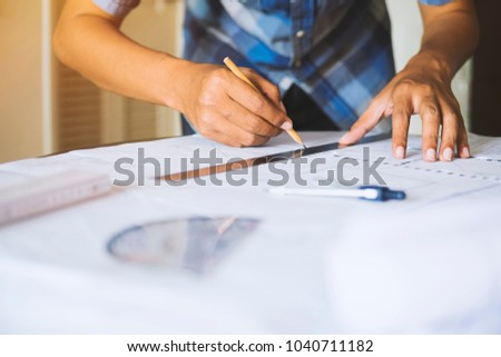 Engineer architect working pointing project drawing stock photo engineer architect working pointing project drawing construction planning blueprint design table in the office workplace malvernweather Gallery