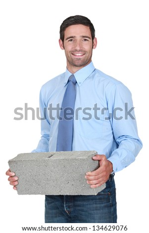 Engineer carrying a stone - stock photo