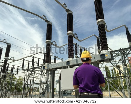 Engineer check power quality in high voltage substation - stock photo