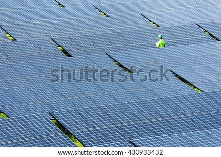 engineer check solar plant - stock photo
