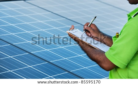 engineer checking solar power station - stock photo