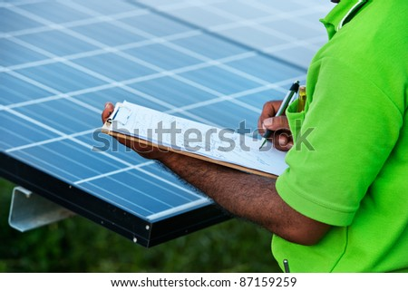 engineer checking solar power station - stock photo