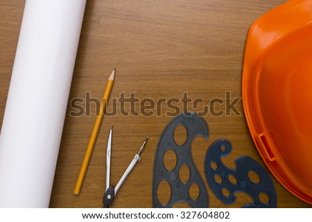 Engineer Construction Accessories - plastic helmet, compass and pencil drawings bundle. - stock photo