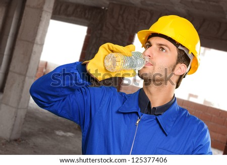 Engineer Drinking Water, Indoors - stock photo