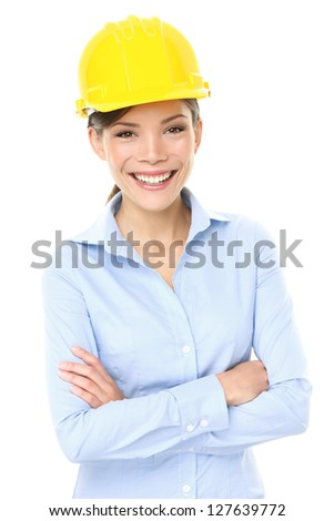 Engineer, entrepreneur or architect business woman. Portrait of smiling happy, proud and confident young multiracial Asian Chinese / Caucasian female professional wearing yellow hard hat. - stock photo