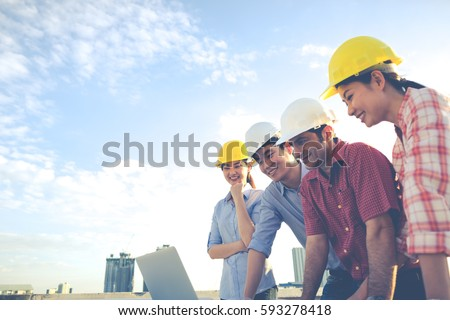 Engineer group worker meeting discussion construction imagen de engineer group and worker meeting discussion with construction blueprint on site work malvernweather Images