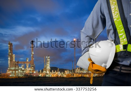 stock-photo-engineer-holding-a-white-hel