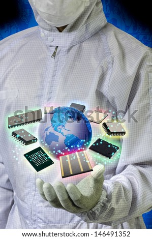 Engineer holding electronics components and illustration globe - stock photo