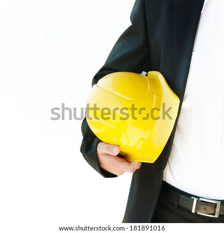 Engineer holding helmet - stock photo