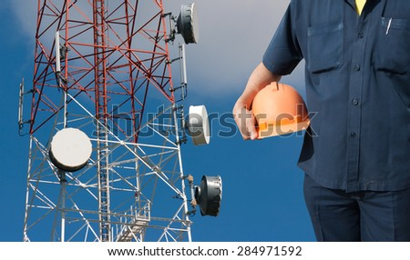 engineer holding orange helmet for workers security on Telecommunications tower background - stock photo