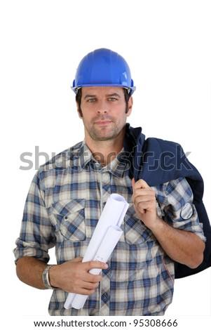 Engineer holding plans - stock photo