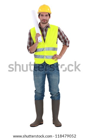 Engineer in a reflective vest with plans - stock photo