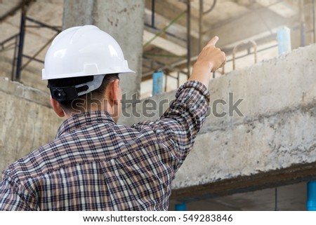 Engineer in building construction site