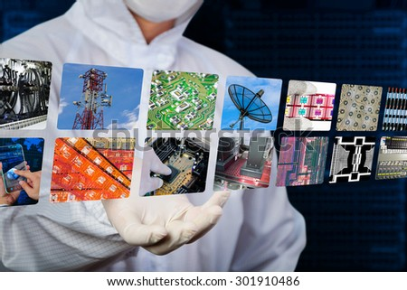 engineer in jumpsuit showing floating picture  - stock photo