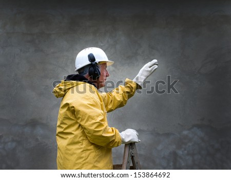 Engineer in safety suit commands - stock photo