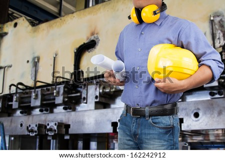 Engineer in the area of the factory.