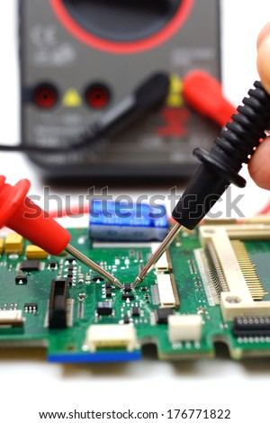 engineer is checking electronic component - stock photo