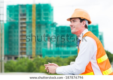 Engineer looking at the building site - stock photo
