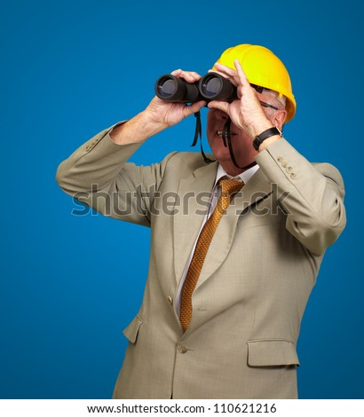 Engineer Looking Away On Blue Background - stock photo