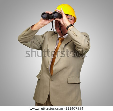 Engineer Looking Away On Gray Background - stock photo