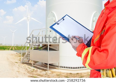 engineer maintaining record wind turbine power generator station  - stock photo