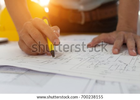 Engineer man architect drawings blueprint construction stock photo engineer man architect drawings blueprint construction stock photo 700238155 shutterstock malvernweather Choice Image