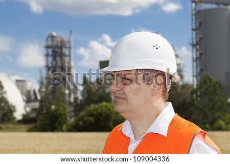 Engineer near the factory - stock photo