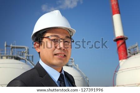 engineer oil refinery standing on location site - stock photo