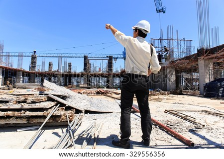Engineer on construction site with blue sky background. - stock photo