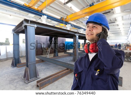 Engineer on the phone in an estabilishment - stock photo