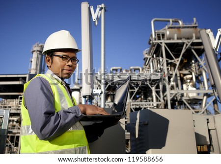 engineer power and energy using laptop on location site - stock photo