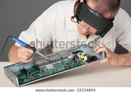 Engineer repairing circuit board, in computer equipment