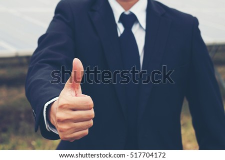 engineer showing thumbs up at solar power plant