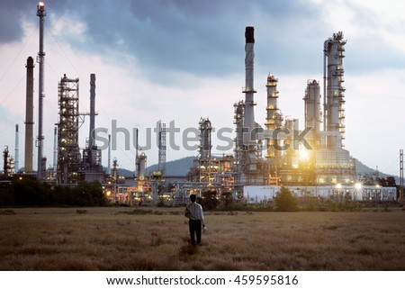 Engineer standing at oil refinery