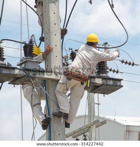 Engineer team working on electrical 22 kv pole - stock photo