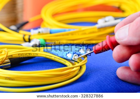 Engineer testing fiber optic cables. - stock photo