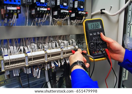 Engineer Tests The Industrial Electrical Circuits With A Multimeter In Control Terminal Box Engineers