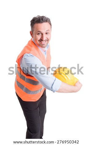 Engineer throwing his yellow helmet and acting happy - stock photo