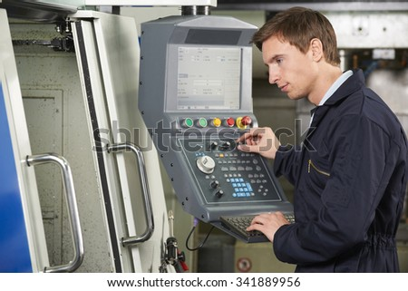 Engineer Using Computer Controlled Cutting Machine