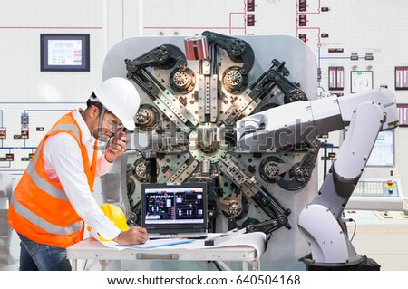 concept machine tool. engineer using laptop computer for maintenance automatic robotic hand machine tool at industrial, industry 4.0 concept e
