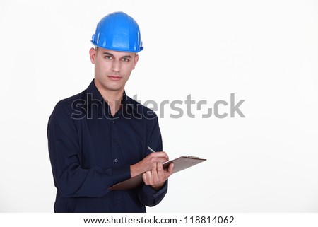 Engineer with a clipboard - stock photo