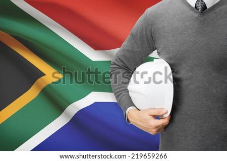 Engineer with flag on background  - South Africa - stock photo