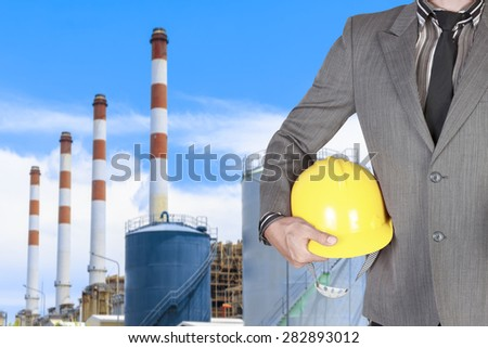 Engineer with helmet in action at modern thermal power plants - stock photo