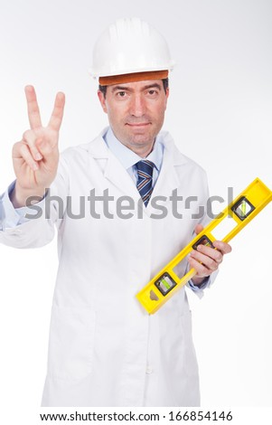 engineer with level with positive expression - stock photo