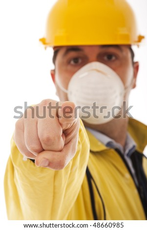 engineer with protective uniform pointing to you (selective focus)