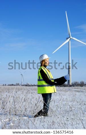 engineer with wind turbines - stock photo