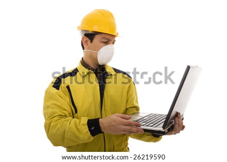 Engineer with workwear, helmet and mask looking to a computer - stock photo