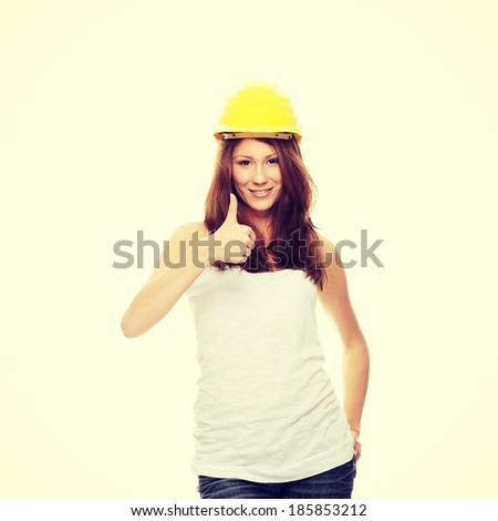 Engineer woman in yellow helmet  - stock photo