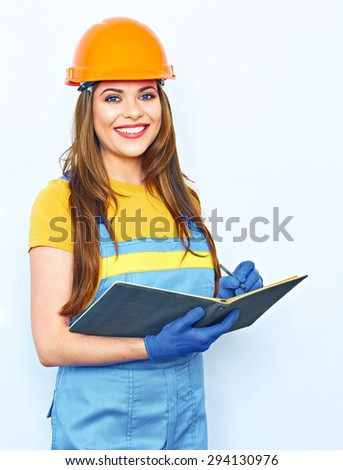 Engineer woman smile, hold business paper. Builder uniform coveralls. Orange protective helmet. - stock photo